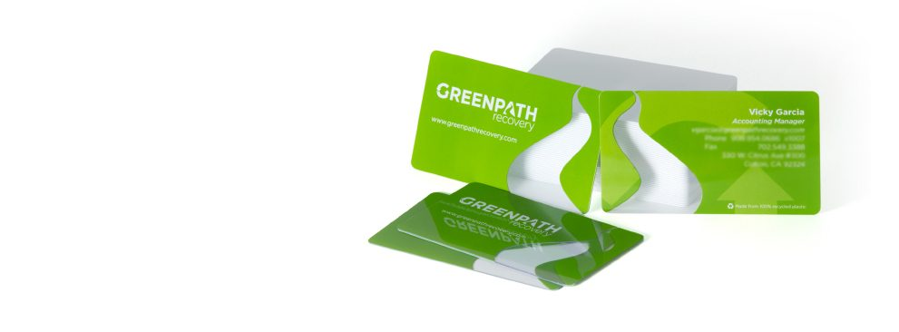 Custom plastic business cards in clear and solid PVC.